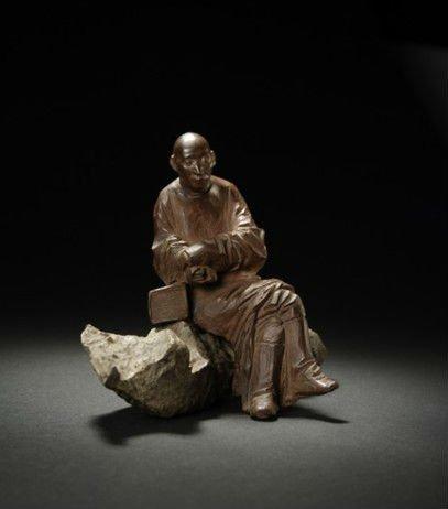 图片说明:西泠印社2012春拍任伯年作紫砂雕塑任淞云小像