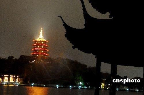 """图:北京""""鸟巢""""为地球一小时活动熄灯"""