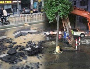 武汉一路面破裂塌陷 水管爆裂数10米路被淹