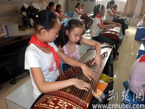 阳光计划举行社团活动在武汉韩家墩小学成长小学生的特别骚图片