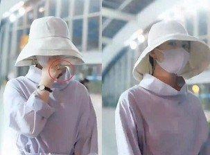 赵丽颖产后四个月现身机场 双手合十婚戒超抢镜
