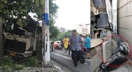 武汉一水泥罐车失控撞穿墙 致路口红绿灯失灵