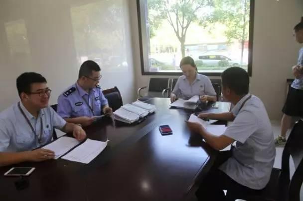 潜江法院举行集中退赔 56名受害人领取千万执行款