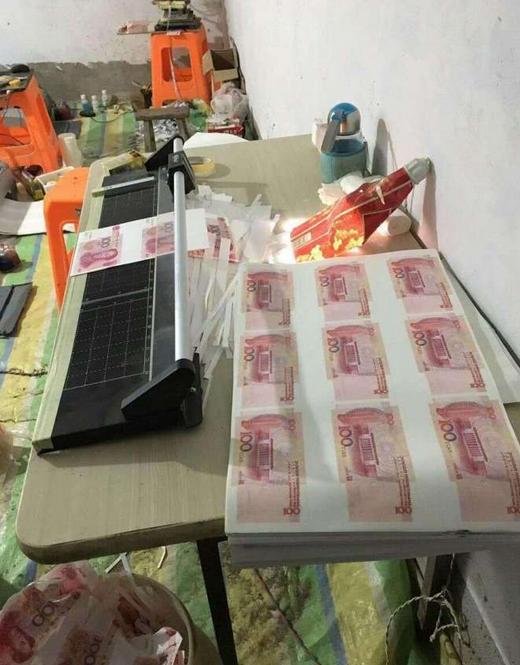 一家三口狂印假钞700万 垃圾桶里都是钱!