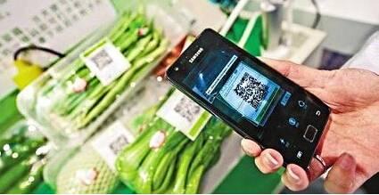 扫着码就能买菜——潜山北路菜市场开始试营业