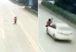 郑州妇女抱着孙女横穿马路 被轿车撞飞