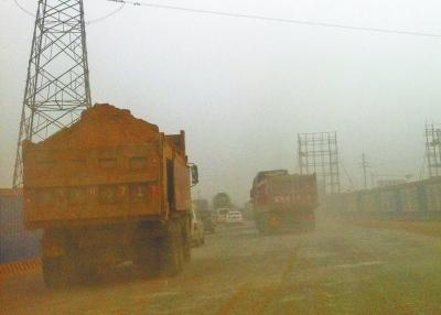 郑州:渣土车一路狂奔一路掉渣者罚款5万元