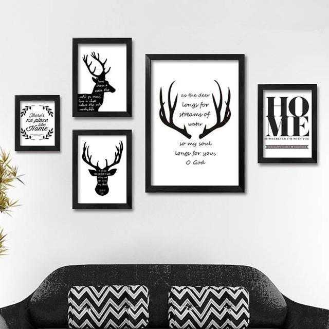 北欧风格可以用些图案简单鲜明的小清新或黑白画,甚至照片墙,美式图片