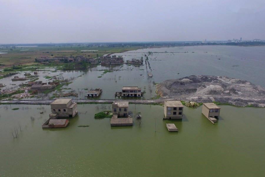 因采煤而被淹没村庄/></a><a href=