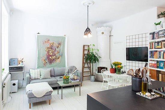 沙发背景墙上的挂布填补了墙面的空白.-现代时尚黑白空间 23图诠图片