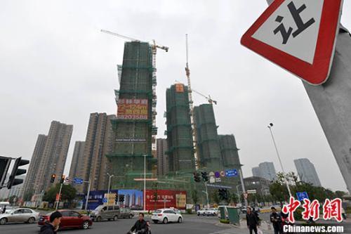 资料图:商品房在建中。 <a target='_blank' href='http://www.chinanews.com/' _fcksavedurl='http://www.chinanews.com/'></table><p  align=
