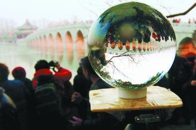 """颐和园十七孔桥今年""""金光""""来得早"""
