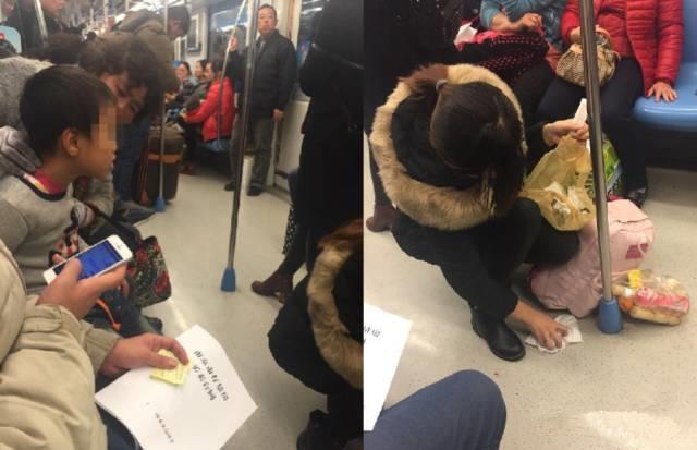 儿子地铁内呕吐 妈妈蹲下把地擦得干干净净