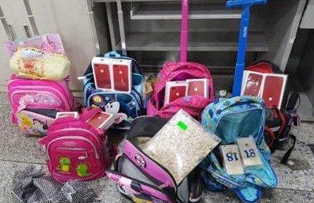 为吃麦当劳,深圳10名学童书包藏210部手机过海关