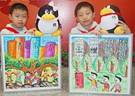 小画家用画笔为玉树小朋友送上六一祝福