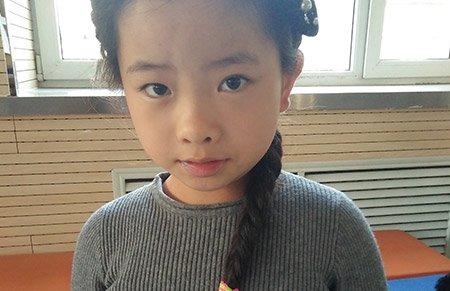 10岁姑娘欲捐齐腰长发 为患癌小朋友做假发