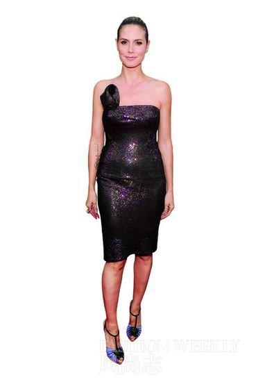 """red carpet dress contest. Heidi Klum 's dress is """" Project Runway"""