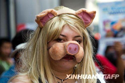组图:墨西哥民众戴面具参加世界动物日活动