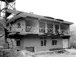 周正龙建起二层小楼 称春节过后将上山找虎