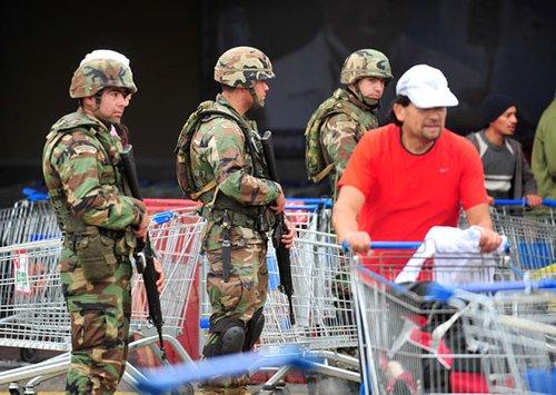 智利延长重灾区宵禁 派上万军人维持治安