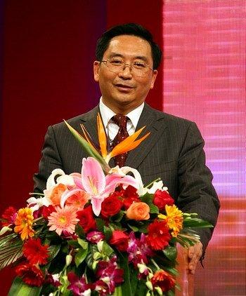 泸州市委书记朱以庄:让农民转为市民