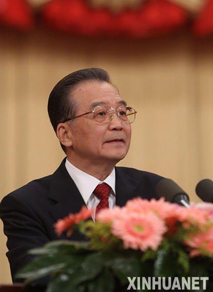 组图:温家宝总理作报告 30次掌声背后是信心