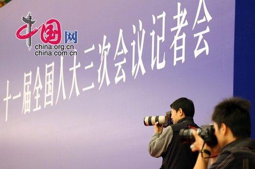 图文:发布会上的摄影记者