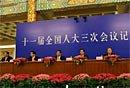 图文:四部委就加强改善宏观调控答记者问