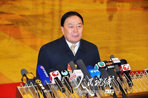 图文:民航总局局长李家祥答记者问