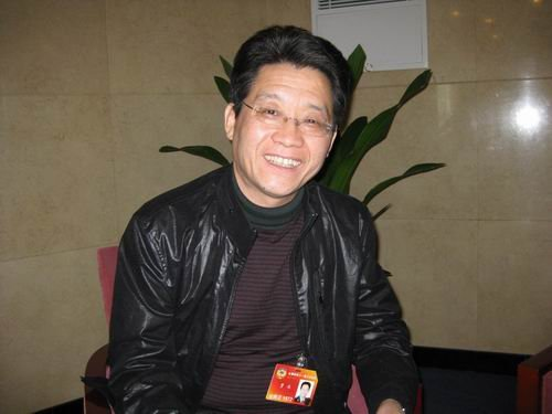 政协委员、新华社解放军分社社长贾永人民网记者崔灿摄
