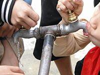 """让旱区每个孩子都能喝上""""纯净水"""""""
