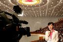 记者在大会上采访
