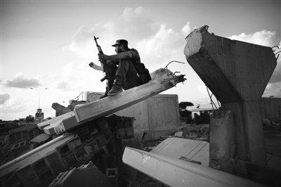 专家称卡扎菲死后利比亚面临多种挑战(图)
