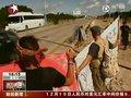 视频:坎昆大会美日作梗 志愿者扮死熊抗议