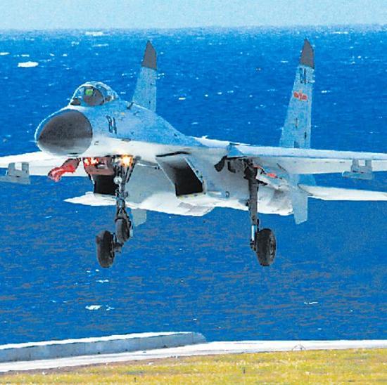 美国若想南海岛礁非军事化 就别派舰机来挑衅
