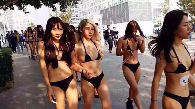 北京警方调查朝阳比基尼女模游街低俗营销(图)