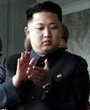 朝鲜在平壤金日成广场举行盛大阅兵式,庆祝朝鲜劳动党成立65周年。这是金正恩在阅兵式开始前走上主席台。