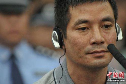 """9月20日,湄公河""""10·5""""案件在昆明市中级人民法院公开开庭审理。图为主犯糯康在庭审现场。中新社发 张浩林 摄"""