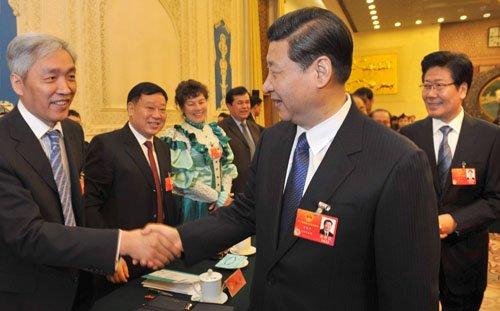 3月9日,中共中央政治局常委、国家副主席习近平,全国人大代表、自治区党委书记张春贤等领导亲切会见新疆代表团成员。