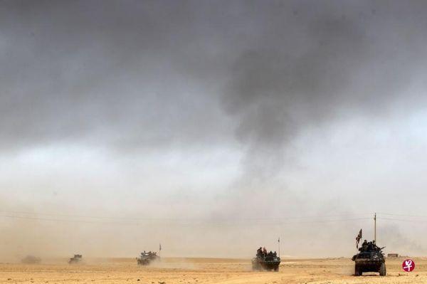 外媒称伊军在摩苏尔IS指挥部四周血战:联军支援