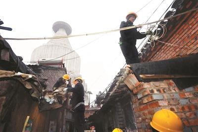 北京拆除白塔寺周边违建 最早违建曾是抗震棚