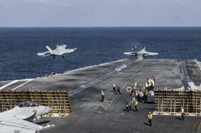 美军航母战斗群进入南海 称对中国发明确信号