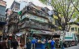 广州老人爱收集垃圾 一次清出2大车