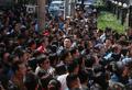 组图:北京不限户籍小学招考被挤爆