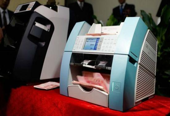 新型验钞机亮相:贪官受贿可查清赃款出处去向