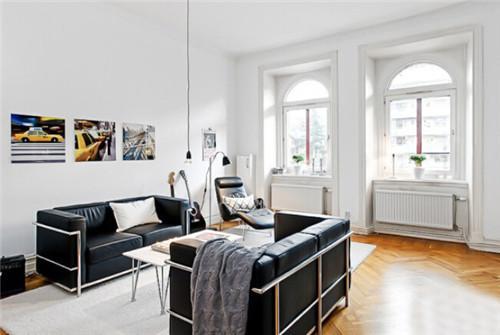 白色的基调营造出浓浓的清新明朗的感觉,客厅设计得很简单,以极致的简图片