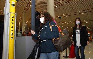 日本撤离回国中国公民抵达北京