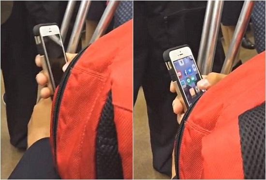 在输入了至少50位密码后,这名男子终于解开了手机屏锁。图为视频截图。