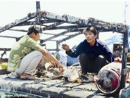 越南抗议中国海军追逐枪击越南渔船导致起火