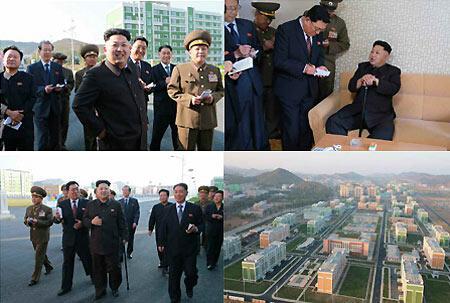 金正恩拄拐前往一处新建成的居住区视察图(来源:朝鲜劳动新闻)